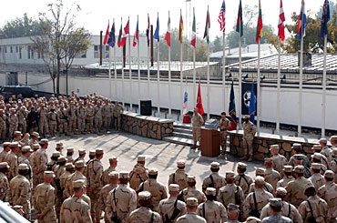 Troops Assembling in Front of the Flags at Camp Eggers, Kabul.