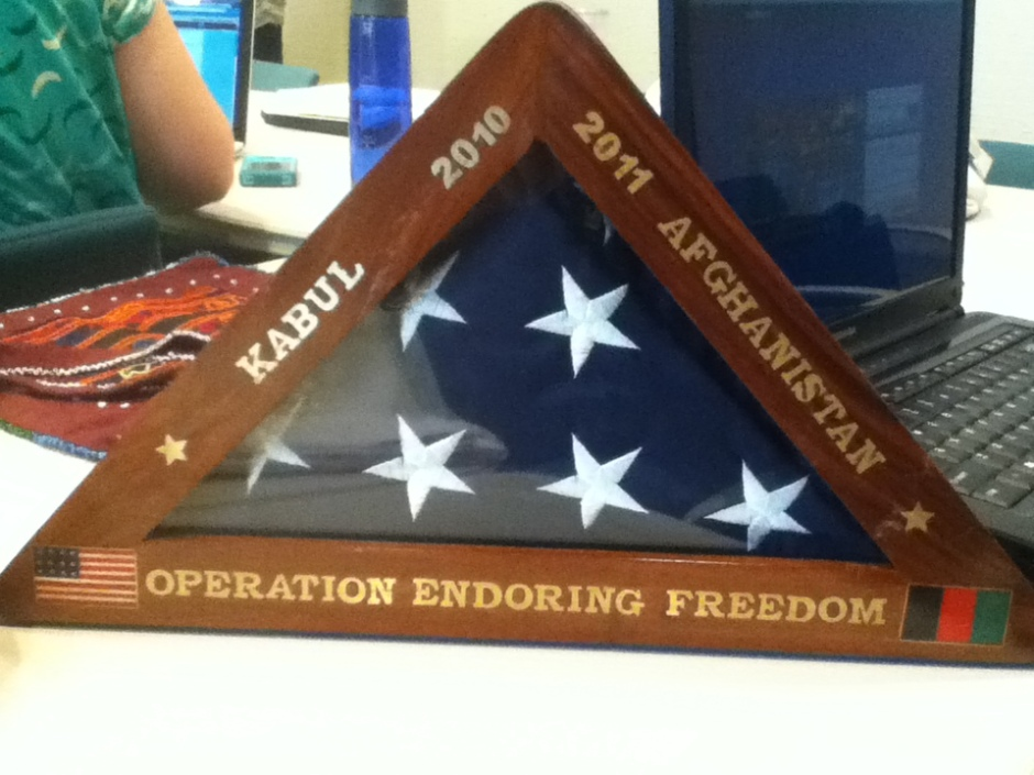 Returned flag as gift with misspelled Enduring. Photo by Alejandro Cuesta.